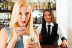 Barista with client in his cafe or coffeeshop Royalty Free Stock Image