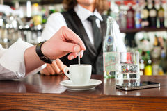 Barista with client in his cafe or coffeeshop Royalty Free Stock Photography