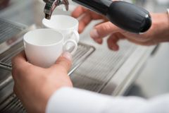 Barista and coffee machine Royalty Free Stock Photography