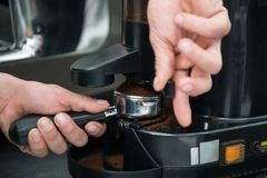 Barista and coffee machine Stock Images