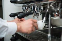 Barista and coffee machine Royalty Free Stock Image