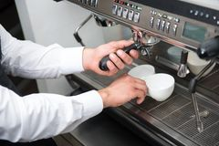 Barista and coffee machine Royalty Free Stock Images