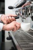 Barista and coffee machine Royalty Free Stock Photos