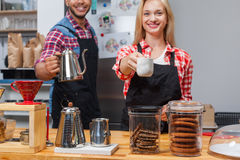 Barista coffee shop owner couple happy smile at bar counter Royalty Free Stock Images