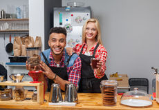Barista coffee shop owner couple happy smile at bar counter Stock Images