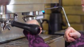 Barista connect portafilter to coffee machine stock video footage