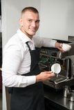 Barista doing your coffee Royalty Free Stock Image