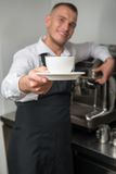 Barista doing your coffee Royalty Free Stock Photos