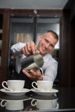 Barista doing your coffee Royalty Free Stock Images