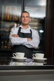 Barista doing your coffee Stock Images