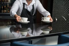 Barista doing your coffee Royalty Free Stock Photography