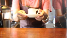 Barista Finishing Cup Of Espresso From Coffee Machine stock footage