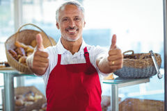 Barista gesturing thumbs up and smiling at camera Stock Images