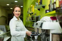 Barista girl making coffee in cafe Stock Images