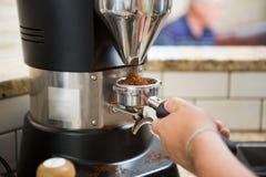 Barista Grinding Coffee imagen de archivo