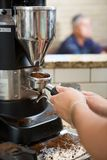 Barista Grinding Coffee Stock Photography