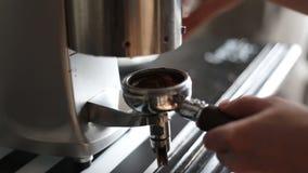 Barista grinds coffee slowmotion