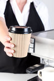 Barista handing you a coffee Stock Image