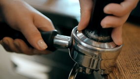 Barista Hands Using a Tamper To Press Freshly Ground Coffee Into a Coffee Tablet stock video footage