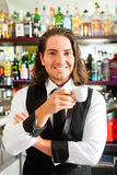 Barista in his cafe or coffeeshop Royalty Free Stock Photos