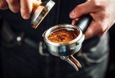 Barista making an espresso coffee. Royalty Free Stock Images
