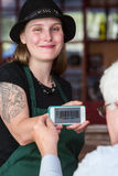 Barista holding smart phone with coupon code Stock Photo