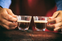 Barista holding two espresso cups Stock Photos
