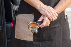 Barista holds coffee strainer Stock Image