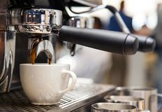 Barista machine in coffee shop. Americano being made. royalty free stock photography