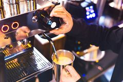 Barista make coffee with coffee machine stock photo