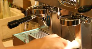 Barista using coffee machine in cafe restaurant. Barista maker using coffee machine in cafe restaurant stock footage