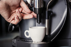 Barista makes coffee with a machine Royalty Free Stock Image