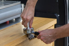 Barista makes coffee. In coffee shop Royalty Free Stock Images