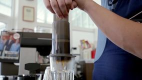 Barista makes coffee using the filter.  stock footage