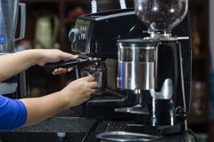 Barista makes coffee Royalty Free Stock Photography