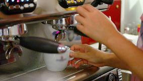 Barista makes coffees in coffee bar stock footage