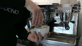 Barista makes two coffees in coffee bar stock video footage