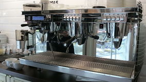 Barista makes two coffees in coffee bar stock video