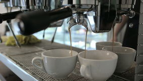Barista makes two coffees in coffee bar stock footage