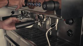 Barista making americano or cappuccino in a stainless steel tumbler on an industrial espresso machine. Close-Up. Concept stock footage