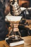 Barista making coffee in coffeeshop. Coffee preparing Royalty Free Stock Photography