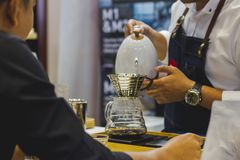 Barista is making coffee. For Customer in shop. stock photo