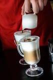 Barista making coffee latte Royalty Free Stock Image