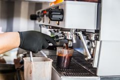Barista making coffee. By coffee machine Royalty Free Stock Images