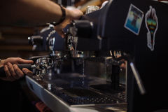 Barista is making coffee. On coffee machine Royalty Free Stock Photo
