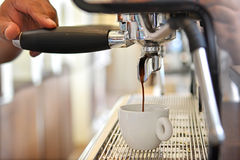 Barista is making coffee. Barista is making coffee from the machine Royalty Free Stock Images