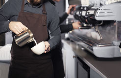 Barista making coffee Royalty Free Stock Photo