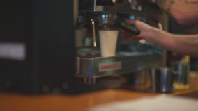 Barista making coffee using espresso machine. Hipster. Making coffee. Barista making coffee using espresso machine. Barista - young stylish man with a beard and stock video footage