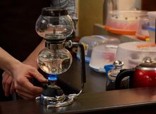 Barista making coffee using special glass jar stock image