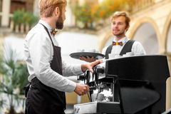 Barista making coffee with waiter Royalty Free Stock Photos